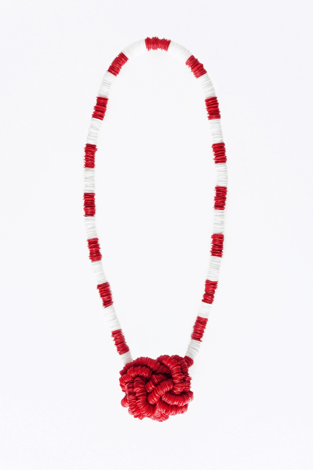 red and whitte plastic necklace